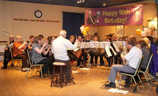Mr Eccles conducts the band at his 90th birthday party