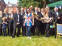 Band, helpers and organiser after the Olympic Torch Relay - click for full size image